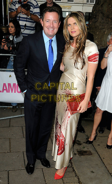 PIERS MORGAN & CELIA WALDEN .Glamour Women Of The Year Awards - Outside Arrivals, Berkeley Square Gardens, London, England, UK, .June 8th 2010. . full length blue suit tie couple red cream dress long maxi print clutch bag.CAP/CAN.©Can Nguyen/Capital Pictures.