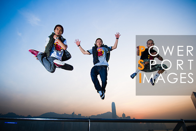 B-Boys Taisuke, Ronnie and Lilou get airborne on Hong Kong's Victoria Harbour waterfront.