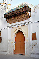 Doorway to the Grand Mosque, 19th century, El Jadida, Morocco. El Jadida, previously known as Mazagan (Portuguese: Mazag√£o), was seized in 1502 by the Portuguese, and they controlled this city until 1769. As the mosque's minaret (visible in the background) is a converted lighthouse, El Jadida is claimed to home the world's only pentagonal minaret. Picture by Manuel Cohen