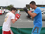 Gerry Owens is trained by Damien McKenna from Holy Family Boxing Club at the Community Fund Launch held at Tesco car park.Photo:Colin Bell/pressphotos.ie