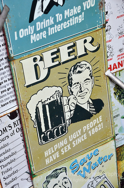 Tin sign promoting beer.