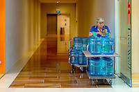 An employee of a company that supplies drinking water delivers to customers in the shopping mall at the Marina Bay Sands resort hotel.