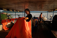 Pakse, Laos, August 18, 2007.Preparing for the evening party on a Karaoke boat on the Mekong.