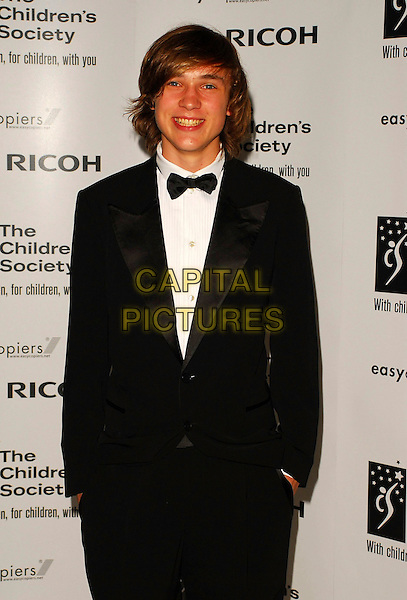 WILLIAM MOSELEY.The Children's Society annual ball, this year celebrating the society's 125th anniversary with a fairytale theme at Claridges Ballroom, London, UK..May 17th, 2006.Ref: CAN.half length tuxedo.www.capitalpictures.com.sales@capitalpictures.com.©Capital Pictures