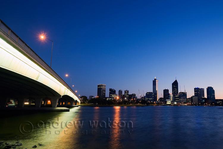 Narrows Bridge and skyline of central Perth on the Swan River at dawn.  Perth, Western Australia, AUSTRALIA.