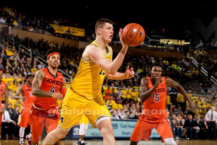 The University of Michigan men's basketball team falls to Virginia Tech, 73-70, at Crisler Arena in Ann Arbor, MI. on November 30, 2016.