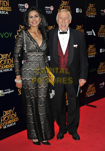 LONDON, ENGLAND - APRIL 02: Wilnelia Merced, Sir Bruce Forsyth attend the Dirty Rotten Scoundrels gala night, Savoy Theatre, The Strand, London, England 2nd April 2014.<br /> CAP/PP/GM<br /> &copy;Gary Mitchell/PP/Capital Pictures