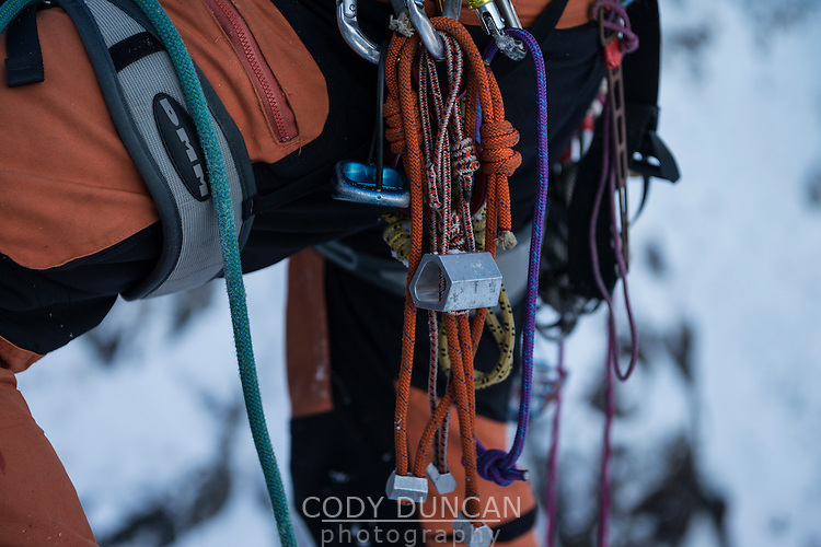 Detail of climbers harness and rack in winter, Lofoten Islands, Norway