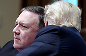 United States President Donald Trump talks to US Secretary of State Mike Pompeo during a cabinet meeting in the Cabinet Room of the White House, July 18, 2018 in Washington, DC. <br /> Credit: Olivier Douliery / Pool via CNP