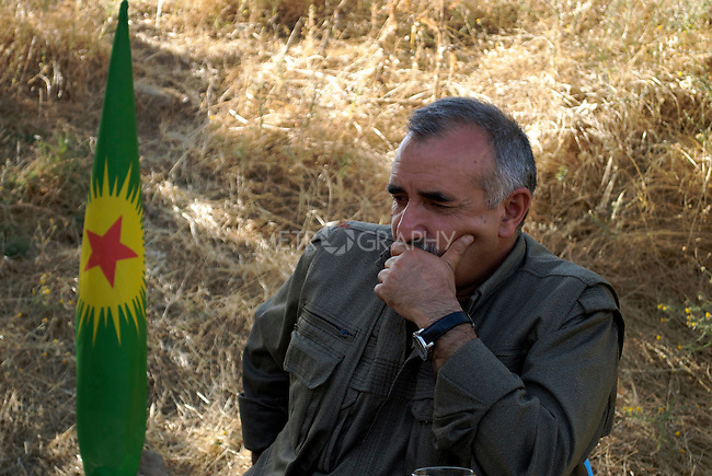 QANDIL, IRAQ: Murad Qarayilan, acting leader of the Kurdistan Worker's Party (PKK) responds to questions during an interview...The Kurdistan Workers' Party (PKK) is a Kurdish organization fighting for Kurdish autonomy in Turkey.  It is deemed a terrorist group by the USA and the EU. The organization's guerillas are based in the Qandil mountains that make up the border between Iraq and Turkey..Photo by Hawre Majid/ Metrography