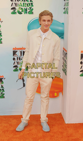 Cody Simpson.arriving at the 2012 Nickelodeon Kids' Choice Awards at Galen Center in Los Angeles, California, USA..March 31st, 2012.full length white cream shirt hand in pocket suit.CAP/ROT/TM.©Tony Michaels/Roth Stock/Capital Pictures