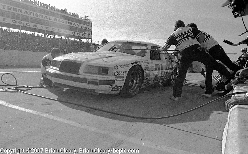 Buddy Baker makes a pit stop in the #21 Valvoline Wood Brothers Ford Thunderbird en route to a 2nd place finish, Atlanta Journal 500 at Atlanta International Raceway in Hampton, GA on November 6, 1983. (Photo by Brian Cleary/www.bcpix.com)