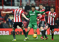 Preston's Callum Robinson battles with Brentford's John Egan and Josh McEachran<br /> <br /> Photographer Jonathan Hobley/CameraSport<br /> <br /> The EFL Sky Bet Championship - Brentford v Preston North End - Saturday 10th February 2018 - Griffin Park - Brentford<br /> <br /> World Copyright &copy; 2018 CameraSport. All rights reserved. 43 Linden Ave. Countesthorpe. Leicester. England. LE8 5PG - Tel: +44 (0) 116 277 4147 - admin@camerasport.com - www.camerasport.com