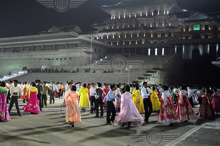 A massed crowd of dancers, rehearse in Kim Il-sung Square, during celebrations marking the 100th birthday of Kim Il-sung.