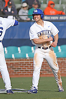 University of Kentucky Wildcats outfielder Austin Cousino #19 celebrating scoring a run during a game against the University of Virginia Cavaliers at Brooks Field on the campus of the University of North Carolina at Wilmington on February 14, 2014 in Wilmington, North Carolina. Kentucky defeated Virginia by the score of 8-3. (Robert Gurganus/Four Seam Images)