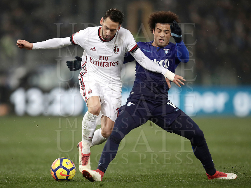 Football Soccer: Tim Cup semi-final second Leg, SS Lazio vs AC Milan, Stadio Olimpico, Rome, Italy, February 28, 2018.<br /> Milan's Hakan Calhanoglu (l) in action with Lazio's Felipe Anderson (r) during the Tim Cup semi-final football match between SS Lazio vs AC Milan, at Rome's Olympic stadium, February 28, 2018.<br /> <br /> UPDATE IMAGES PRESS/Isabella Bonotto