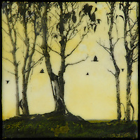 Yellow encaustic painting with photo transfer of trees and birds
