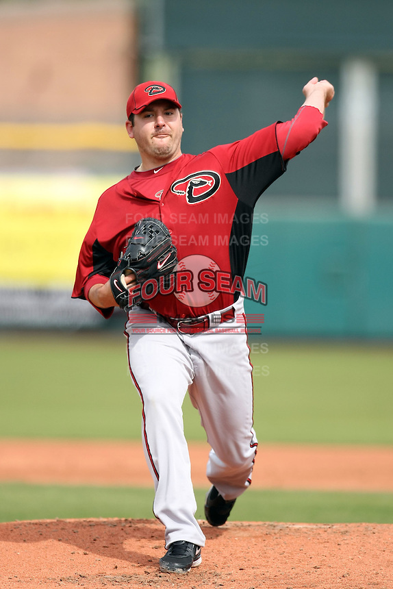 Joe Saunders #34 of the Arizona Diamondbacks pitches against the San Francisco Giants in the first spring training game of the season at Scottsdale Stadium on February 25, 2011  in Scottsdale, Arizona. .Photo by:  Bill Mitchell/Four Seam Images.