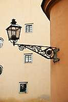 Street light on side of building, Gamla Stan - Old town, Stockholm, Sweden