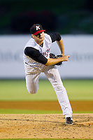 Kannapolis Intimidators relief pitcher Stew Brase (14) delivers a pitch to the plate against the Greensboro Grasshoppers at CMC-Northeast Stadium on July 12, 2013 in Kannapolis, North Carolina.  The Grasshoppers defeated the Intimidators 2-1.   (Brian Westerholt/Four Seam Images)