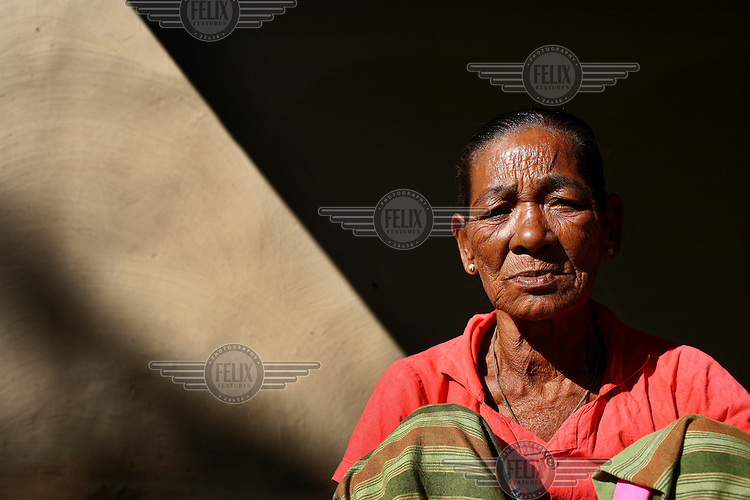A Garo women. The Garo (or Mandi, as they refer to themselves) are an ethnic minority thought to be of Tibeto-Burmese origin. Prior to British rule they were mostly anamists but missionary work led the majority to convert to Christianity. The Garo of the Madhupur forest have long been under the threat of eviction by the government and the forest that they gain much of their livelihood from is being rapidly destroyed by unregulated logging.