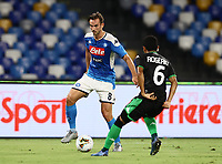 25th July 2020; Stadio San Paolo, Naples, Campania, Italy; Serie A Football, Napoli versus Sassuolo; Fabian Ruiz of Napoli is challenged by Rogério of Sassuolo
