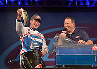 NWA Democrat-Gazette/BEN GOFF -- 04/26/15 Cody Meyer, FLW pro from Auburn, Calif., weighs in with Master of Ceremonies Chris Jones on the final day of the Walmart FLW Tour at Beaver Lake at the John Q. Hammons Center in Rogers on Sunday Apr. 26, 2015.
