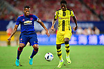 Manchester United winger Antonio Valencia (l) fights for the ball with Borussia Dortmund striker Ousmane Dembele (r) during the International Champions Cup China 2016, match between Manchester United vs Borussia  Dortmund on 22 July 2016 held at the Shanghai Stadium in Shanghai, China. Photo by Marcio Machado / Power Sport Images