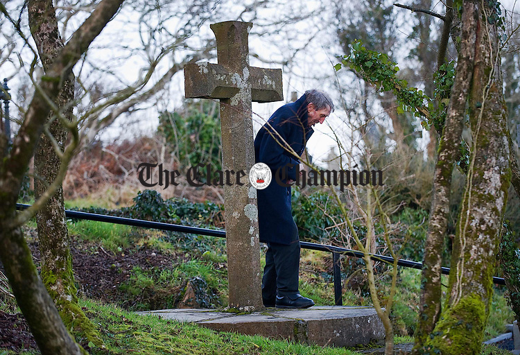"A man does ""the rounds"" during a visit to St Bridgid's Well on the feast of St Bridgid. Photograph by John Kelly."