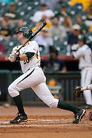 Adam Hornung #20 of the Baylor Bears follows through on his swing versus the Houston Cougars in the 2009 Houston College Classic at Minute Maid Park February 27, 2009 in Houston, TX.  The Bears defeated the Cougars 3-2. (Photo by Brian Westerholt / Four Seam Images)
