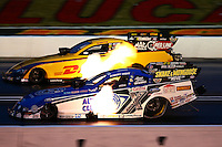 Aug. 31, 2013; Clermont, IN, USA: NHRA funny car driver Robert Hight (near) races alongside Del Worsham during qualifying for the US Nationals at Lucas Oil Raceway. Mandatory Credit: Mark J. Rebilas-