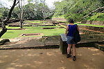 Woman tourist in the water gardens of Sigiriya rock palace, Central Province, Sri Lanka, Asia