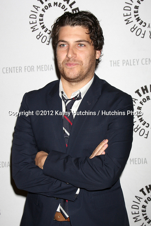 """LOS ANGELES - OCT 16:  Adam Pally arrives at  An Evening With """"Happy Endings"""" And """"Don't Trust The B---- In Apartment 23"""" at Paley Center For Media on October 16, 2012 in Beverly Hills, CA"""