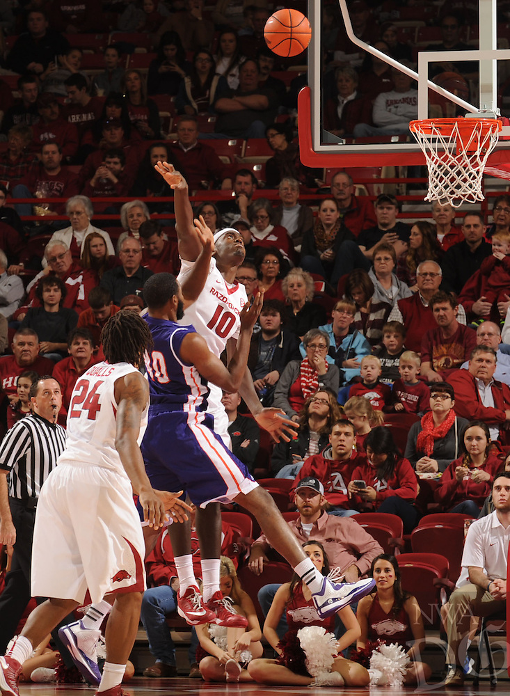 NWA Media/ANDY SHUPE - Arkansas' Bobby Portis (10) reaches to block a shot by Northwestern State's Marvin Frazier (40) during the second half of the Razorbacks' 100-92 win Sunday, Dec. 28, 2014, in Bud Walton Arena in Fayetteville.