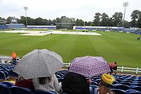 Spectators shelter under umbrellas as heavy rain falls ahead of Glamorgan vs Essex Eagles, NatWest T20 Blast Cricket at the SSE SWALEC Stadium on 23rd July 2017