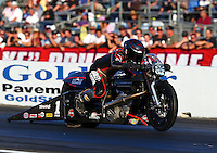 Nov 10, 2013; Pomona, CA, USA; NHRA pro stock motorcycle rider Eddie Krawiec during the Auto Club Finals at Auto Club Raceway at Pomona. Mandatory Credit: Mark J. Rebilas-