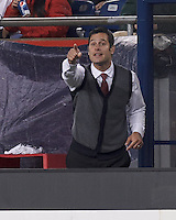 New York Red Bulls coach Mike Petke gets involved. In a Major League Soccer (MLS) match, the New England Revolution (blue) tied New York Red Bulls (white), 1-1, at Gillette Stadium on May 11, 2013.