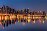Buildings on the West Side of Manhattan, from  approximately 72nd Street south to 54th Street, and their reflections on the Hudson River during the last hour before sunrise.