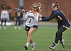 Paige Accurso #1 of Manhasset, left, gets pressured by Kerri Radomski #15 of Massapequa during a Nassau County varsity girls lacrosse game at Manhasset High School on Tuesday, March 27, 2018. Manhasset won by a score of 11-8.