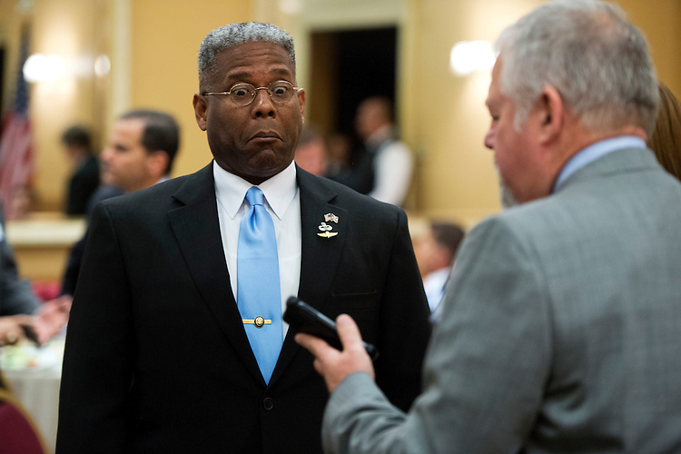 UNITED STATES - AUGUST 23:  Rep. Allen West, R-Fla., of Florida's 18th District, reacts to a picture of himself during a meeting of the Independent Insurance Agents of Palm Beach County, in West Palm Beach, Fla.  West is running against democrat Patrick Murphy.  (Photo By Tom Williams/CQ Roll Call)