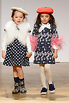 Models walk runway in outfits from the Charabia collection during the petitePARADE fashion show at Children's Club in the Jacob Javits Center in New York City on February 25, 2018.