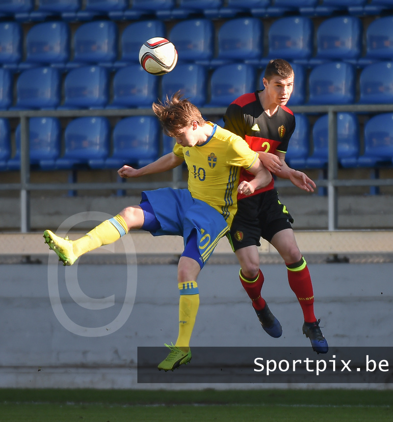 20170323 - BEVEREN , BELGIUM : Swedish Carl Johansson (L) and Belgian Kino Delorge (R) pictured during the UEFA Under 19 Elite round game between Sweden U19 and Belgium U19, on the first matchday in group 7 of the Uefa Under 19 elite round in Belgium , thursday 23 th March 2017 . PHOTO SPORTPIX.BE | DIRK VUYLSTEKE