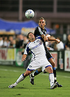 Lance Watson (left) and Darren Huckerby (right) battle for the ball. The San Jose Earthquakes defeated the Kansas City Wizards in stoppage time 1-0 at Buck Shaw Stadium in Santa Clara, California on August 22, 2009.