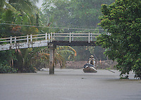 Almost zero visibility during a heavy Monsoon rain storm. Near Can Tho, the hub of the Mekong Delta (Vietnamese: Đồng bằng S&ocirc;ng Cửu Long &quot;Nine Dragon river delta&quot;), also known as the Western Region (Vietnamese: Miền T&acirc;y or the South-western region (Vietnamese: T&acirc;y Nam Bộ) is the region in southwestern Vietnam where the Mekong River approaches and empties into the sea through a network of distributaries. The Mekong delta region encompasses a large portion of southwestern Vietnam of 39,000 square kilometres (15,000&nbsp;sq&nbsp;mi). The size of the area covered by water depends on the season.<br />