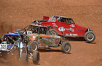 Apr 17, 2011; Surprise, AZ USA; LOORRS driver Kevin McCullough (389) leads Bradley Morris (304) during round 4 at Speedworld Off Road Park. Mandatory Credit: Mark J. Rebilas-