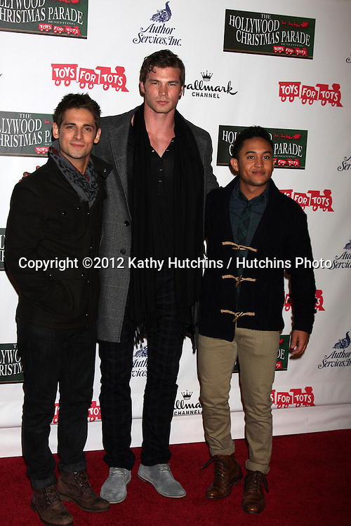 LOS ANGELES - NOV 25:  Jean-Luc Bilodeau, Derek Theler, Tahj Mowry arrives at the 2012 Hollywood Christmas Parade at Hollywood & Highland on November 25, 2012 in Los Angeles, CA