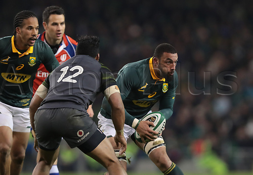 11th November 2017, Aviva Stadium, Dublin, Ireland; Autumn International Series, Ireland versus South Africa; Uzair Cassiem (South Africa) is about to be tackled by Bundee Aki (Ireland)