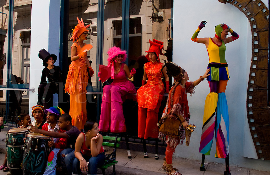 Havana capitol city of Cuba closeup of parade in Old Havana with stilts and colors and party atmosphere on streets