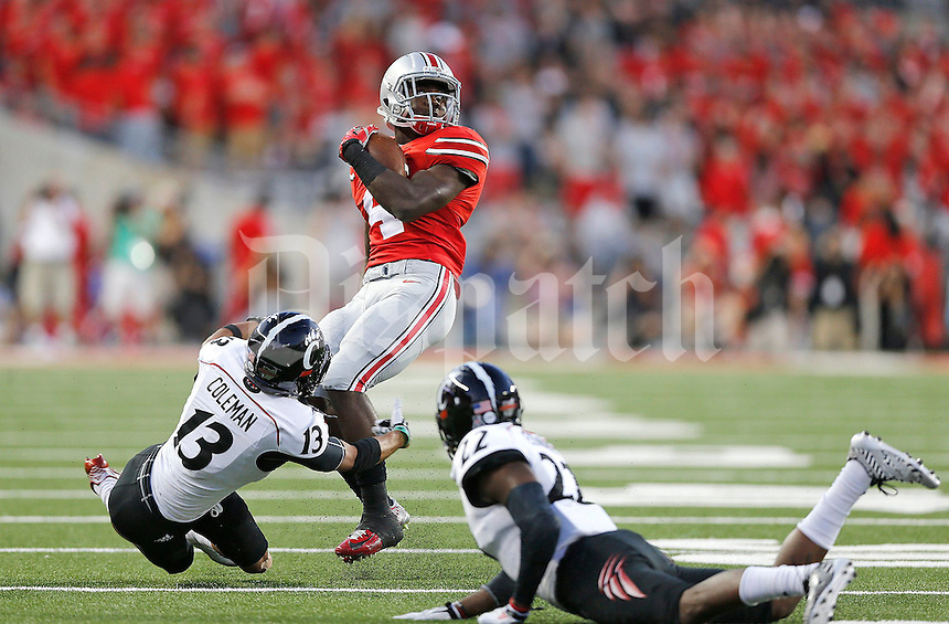 Ohio State Buckeyes running back Curtis Samuel (4) twists past Cincinnati Bearcats cornerback Grant Coleman (13) during the second quarter of Saturday's NCAA Division I football game at Ohio Stadium in Columbus on September 27, 2014. (Columbus Dispatch photo by Jonathan Quilter)