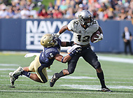 Annapolis, MD - October 21, 2017: UCF Knights running back Taj McGowan (12) stiff arms Navy Midshipmen safety Sean Williams (6) during the game between UCF and Navy at  Navy-Marine Corps Memorial Stadium in Annapolis, MD.   (Photo by Elliott Brown/Media Images International)